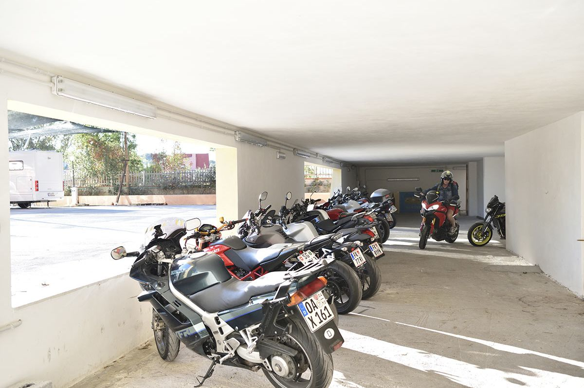 Camping Village Telis - Car and motorbike covered parking.